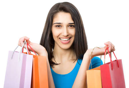 Portrait of a beautiful woman with colored shopping bags isolated on white. Stock Photo - 17817104
