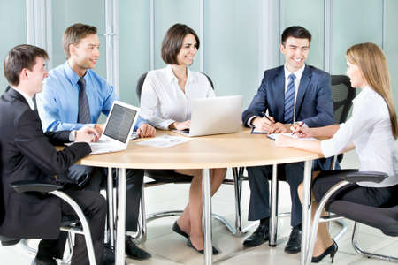 businessteam: Business people. Business team working on their business project together at office. Stock Photo