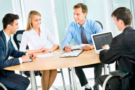 consulting team: Business people. Business team working on their business project together at office. Stock Photo