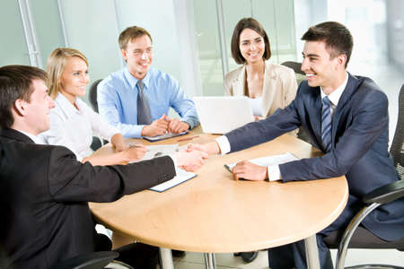 consensus: Business people shaking hands, finishing up a meeting Stock Photo