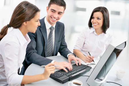 financial guidance: Business people. Business team working on their business project together at office. Stock Photo