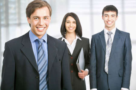 businessteam: Business man standing in front of her colleagues