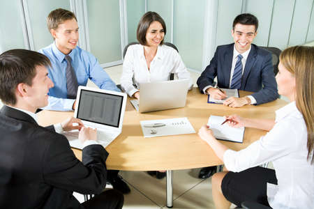 business advice: Business people. Business team working on their business project together at office. Stock Photo