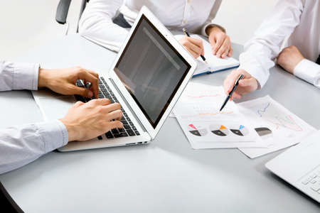 Group of business people busy discussing financial matter during meeting Stock Photo - 19156670