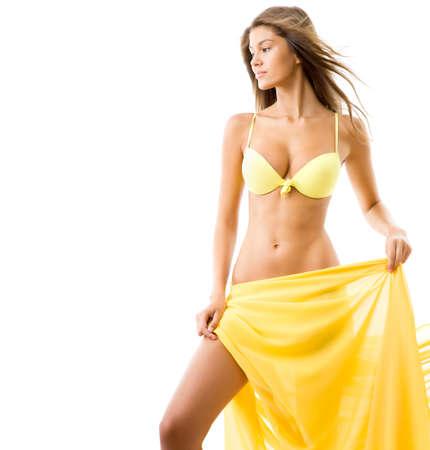 hot breast: Sexy young woman in yellow bikini Фото со стока