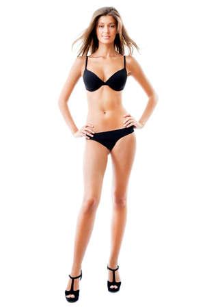 jungen unterwäsche: Volle L?nge Portr?t einer atemberaubenden jungen Dame posiert in Dessous auf wei?em Hintergrund