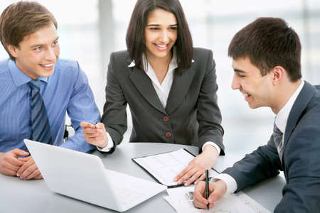 Group of business people busy discussing financial matter during meeting photo