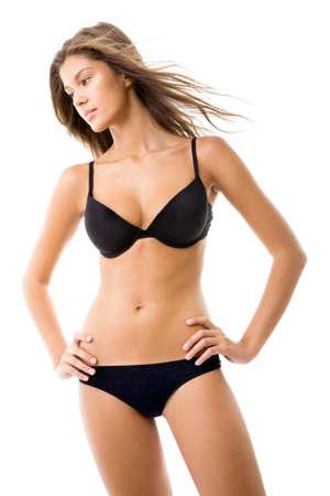 vrouw ondergoed: Portret van een prachtige jonge dame poseren in lingerie op een witte achtergrond Stockfoto