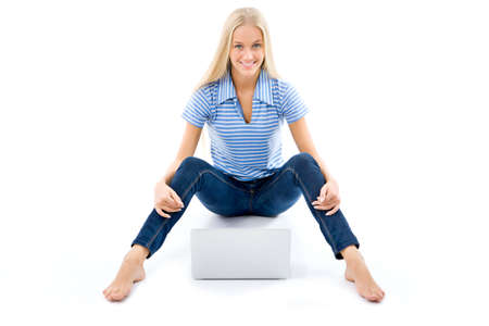 Portrait of a happy young girl with laptop computer isolated over white background photo