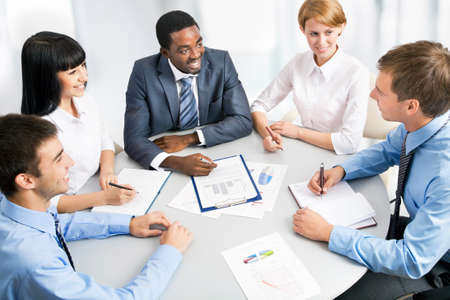 Business group meeting portrait - Five business people working together. A diverse work group. Stock Photo - 19385546