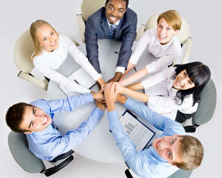 african business man: View from above of business team making pile of hands on working place
