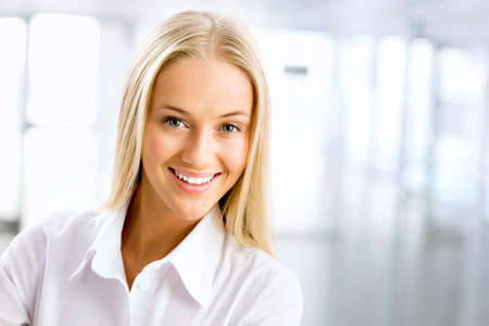 woman smiling: Closeup portrait of cute young business woman smiling