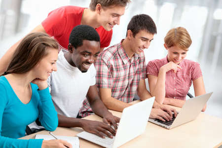 Group of young students studying together in a college Stock Photo