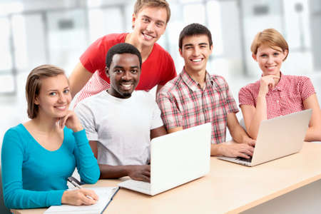 Group of young students studying together in a college photo