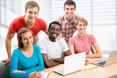 International group of students studying together in a university photo