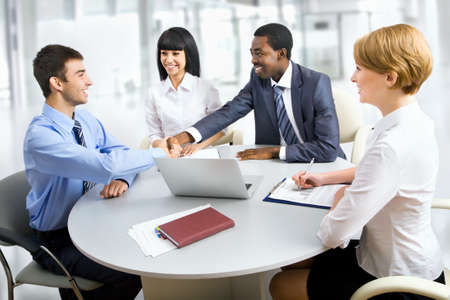 international business agreement: Business people shaking hands, finishing up a meeting Stock Photo