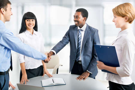 hands shaking: Business people shaking hands, finishing up a meeting Stock Photo