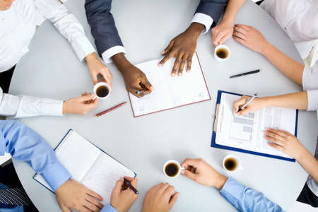 meeting place: Image of business people hands working at meeting