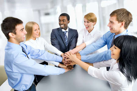 team winner: International  business team showing unity with their hands together Stock Photo