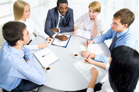 serious meeting: Business people working together. A diverse work group.