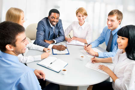 people communicating: Image of businesspeople working at meeting Stock Photo