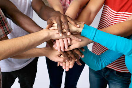 african solidarity: Team of friends showing unity with their hands together