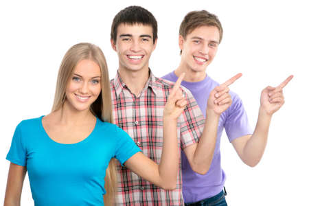 Group of happy students pointing on white background photo