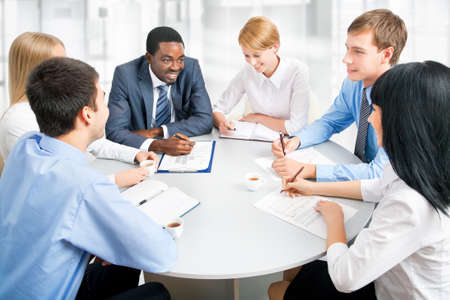 people working together: Business people working together. A diverse work group.
