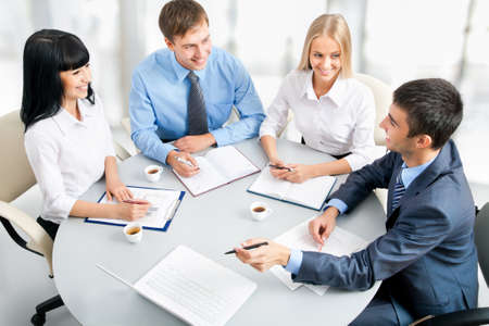 lady boss: Image of businesspeople working at meeting Stock Photo