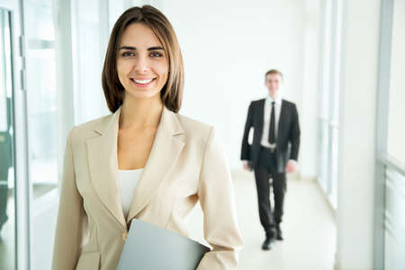 Business woman walking in the office corridor
