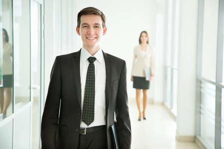 go inside: Businessman walking in the office corridor Stock Photo
