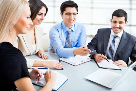 legal advice: Group of happy business people in a meeting at office