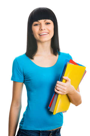 Nice female student smiling and looking at camera Stock Photo