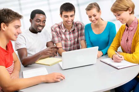 International group of students studying together in a university Stock Photo