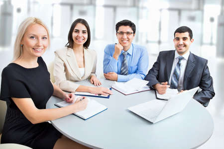 Business team working on their business project together at office Stock Photo - 20751405