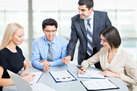 Business team working on their business project together at office Stock Photo - 20751407