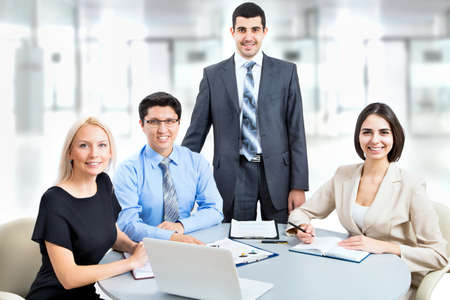 Business team working on their business project together at office Stock Photo - 20751408