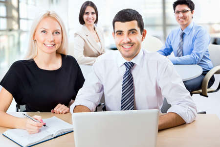 company employee: Business team working on their business project together at office