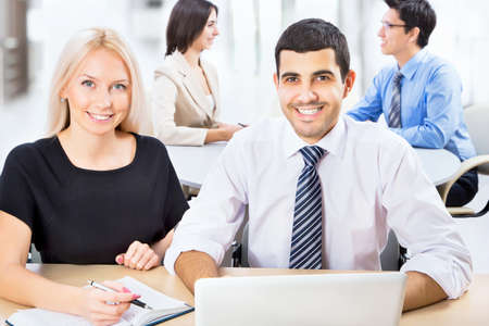 Business people working with laptop in an office Stock Photo - 20751424