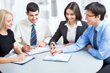 Business team working on their business project together at office Stock Photo - 20751547