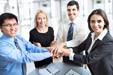 joining hands: Business team putting their hands on top of each other