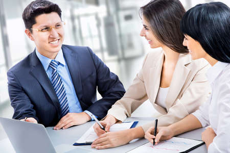 A business team of four plan work in office photo