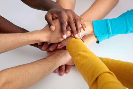 joined hands: Closeup of business team putting their hands on top of each other Stock Photo