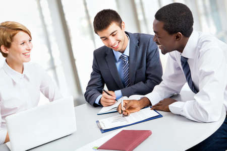 Business team working on their business project together at office Stock Photo - 20751748