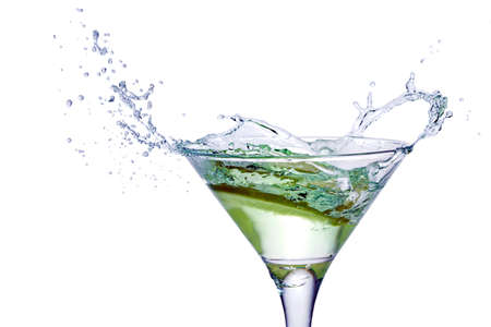 cocktail party: Glass with juice and lemon on the white background Stock Photo