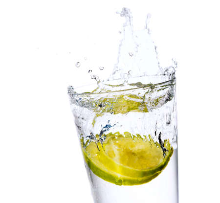 coctail: Glass with juice and lemon on the white background Stock Photo