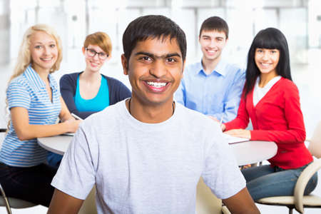Young indian student and his diversity friends on background Banque d'images