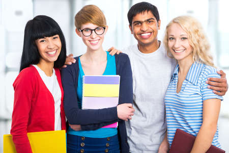 japanes: Group of happy students on a white background Stock Photo