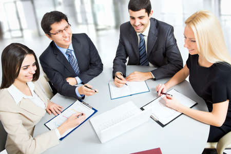 A business team of four plan work in office Banque d'images