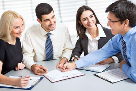 financial advice: Business team working on their business project together at office
